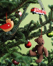 Create a new tradition this year by having your children create their own ornament out of a favorite tiny toy.
