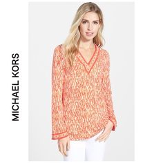 """NEW MICHAEL Kors orange long sleeve v neck top XL Cozy comfy authentic by MICHAEL Kors. A relaxed tunic cut from matte jersey sports a summery print in a choice of vibrant colors accented with a contrasting tile-print border around the V-neckline and cuffs. 27"""" length Long sleeves; side vent. 95% polyester, 5% elastane. MICHAEL Michael Kors Tops Tees - Long Sleeve"""