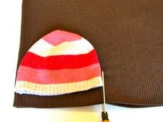 Hat pattern using an old sweater, though I'll bet a sweatshirt or some felt, flannel, or whatnot would do, too. (Ooooh...flannel hat!)