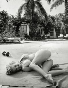 Marilyn Monroe, never understood why she was upside down in this shoot, but these are real unretouched celebrity thighs.