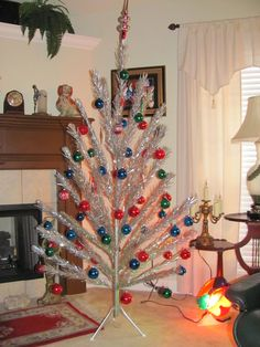 vintage aluminum Christmas tree with color wheel like grandparents used to have.