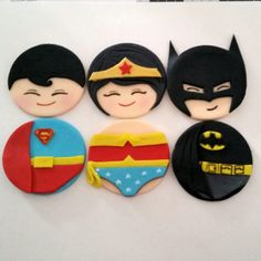 Superman, Wonder woman, and Batman toppers.