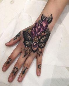 The style of this tattoo is creative and the design itself is pretty out of this world. The perfectly symmetrical butterfly is colored in lots of dark shades and being surrounded by geometric shapes for an innovative finish.