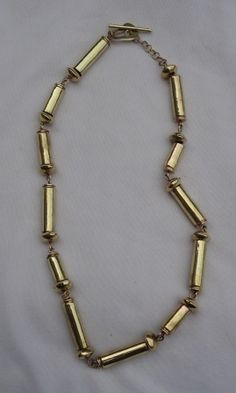 Jewellery Made From Recycled Brass Bullet Shell Necklace, ethically handmade by disadvantaged home based workers.