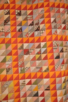 HST blocks bordered with red/cheddar HST blocks.  Quilt Festival Favs | Amybarickman.com