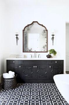 Los Angeles designer Betsy Burnham creates a stunning Moroccan inspired master bath in black and white. Bathroom design inspiration.