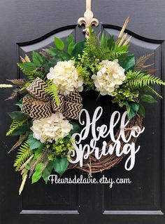 Gorgeous Year Round Door Wreath! This gorgeous BEST SELLING wreath is perfect for greeting your guests to your home, with this one of a kind door wreath. Made up on an 18 grapevine wreath with moss, mixed flowing greenery of ivies, ferns and ficus leaves. Beautiful cream hydrangeas