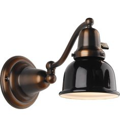 The Halfway. Swing-arm wall fixture in Antique Copper finish with black metal dome shade. Great for lighting tight spots.