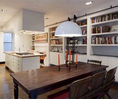 Kitchen bookshelves galore--complete with a sliding library ladder!