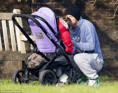 Daddy Beckham and Harper out for a stroll in their iCandy.