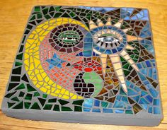 This is one of my the first mosaics I made. It's a stepping stone next to the pond in my backyard. Mosaic Garden, Mosaic Art, Mosaics, Mosaic Stepping Stones, Day For Night, Sun Moon, Stained Glass, Sweet Home, Interior Decorating