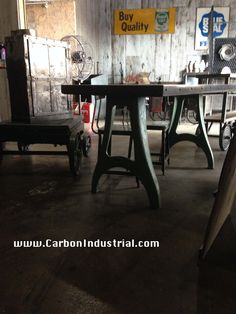 Reclaimed wood top dining table on vintage cast iron machine legs. Made by Carbon Industrial Design.