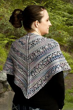 This shawl uses panels of lace interspersed with stockinette stitch to show off the lovely color runs in the yarn, as it was designed for a variegated yarn.