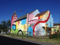 "Atlanta-based artist Alex ""Hense"" Brewer was commissioned last year to convert an abandoned church into a vibrant, eye-catching work of art. Located at 700 D..."