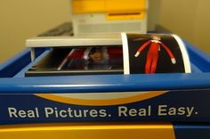 Alpine's Kodak digital picture kiosk has been busy this week with folks printing Christmas cards and photos. Apparently Andy the Alpine Elf thought he needed to update his self-portrait, too. Let the friendly elves at Alpine help you with your holiday photo printing projects!