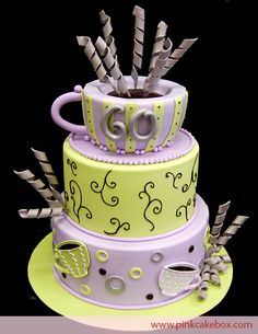 The top tier of this 60th birthday cake includes a coffee cup with lime and lavender stripes. We piped brown curls on the middle tier and included lavender