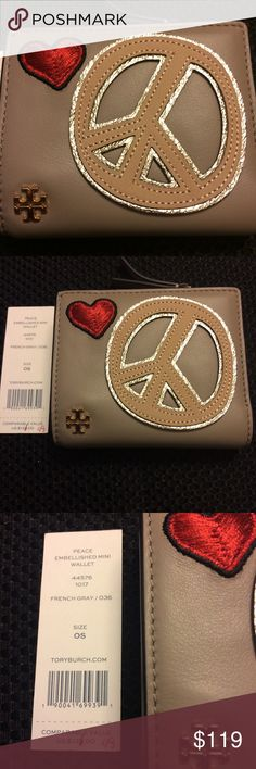Tory Burch French Gray Peace Love Mini Wallet Tory Burch Peace Love Mini Wallet. Snap closure, zip coin pocket, 2 billfolds and 6 card slots. French grey. Tory Burch Bags Wallets