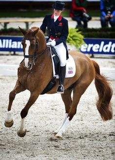 """British dressage rider Laura Bechtolsheimer doing a lovely canter pirouette on her 2008 Olympic partner and favorite horse, Mistral Hojris (""""Alf"""")."""