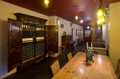 Wine bar Cellar Magneval in Fleet, Hampshire, UK. Featuring book case, vintage piano, wine racking and bus seating