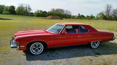 One of the 23,963 Grand Ville 2-door hardtop coupes built by PMD for the 1973 model year; code 75 Buccaneer Red was a little louder than the typical hue selected by Mr. & Mrs. America.