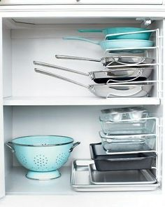 Turn a vertical bakeware organizer on its end to stack pots and pans instead of nesting them.