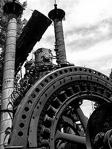 Dr. Evermor's Forevertron- The sculpture incorporates two Thomas Edison dynamos from the 1880s, lightning rods, high-voltage components from 1920s power plants, scrap from the nearby Badger Army Ammunition Plant, and the decontamination chamber from the Apollo 11 spacecraft. Its fictional creator, Dr. Evermor, was born Tom Every in Brooklyn, Wisconsin and is a former demolition expert who spent decades collecting machinery for the sculpture and the surrounding fiction that justifies it.