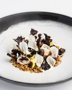 Aged black pig pancetta, walnuts, grains, pickled mushrooms, pepitas, black vinegar-soaked laver.