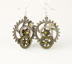 """Made in U.S.A Style # 5003D Size 1.65"""" x 1.5"""" Kinetic Gear Earring 5003D All Gears Move! Comes as shown -Gray/Apple Green/Natural Wood Made from sustainably sourced materials Laser-cut wood Stained with water based dye Ear wires are silver-finished 3041 stainless steel with new electrophoretic-coating that resists tarnishing"""