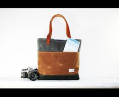 Unique tote / carry all bag with 2 front compartments and 3 interior pockets. All heavy duty waxed canvas and blue cotton interior lining , genuine