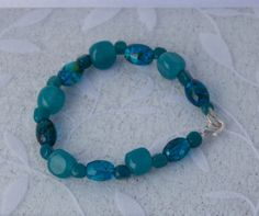 Shop for bracelet on Etsy, the place to express your creativity through the buying and selling of handmade and vintage goods. Turquoise Bracelet, Beaded Necklace, Teal, Trending Outfits, Unique Jewelry, Bracelets, Handmade Gifts, Beaded Collar, Kid Craft Gifts