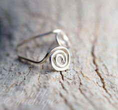 Hey, I found this really awesome Etsy listing at https://www.etsy.com/uk/listing/38403740/squiggle-shape-sterling-silver-hammered