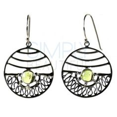 Felicity Sterling Silver and Peridot Earrings - The top half of the polished silver circle is lined with curved bars while the bottom half is composed of a pattern that resembles folded ribbon. In the center of it all is a marvelous round green peridot.  http://simplybeautiful2012.com/felicity-sterling-silver-and-peridot-earrings.html#