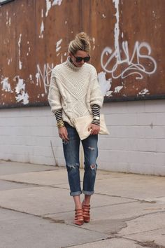 winter: cable-knit sweater with striped long sleeve shirt.