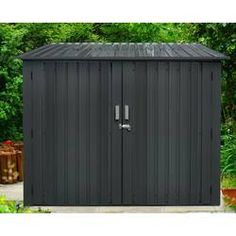 Hanover Galvanized Steel Bicycle Storage Shed with Sliding Bolt Lock for up to 4 Bikes, Dark Gray, HANBIKESHD-GRY-Store and protect up to four adult-size bikes with Hanover's backyard bicycle storage shed. Constructed from galvanized steel, this stro Plastic Storage Sheds, Metal Storage Sheds, Metal Shed, Garbage Storage, Bicycle Storage Shed, Bike Shed, Portable Sheds, Garbage Shed, Steel Sheds