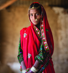 "yahoonewsphotos: "" Faces of Courage – Intimate Portraits of Women on the Edge In the rural Pali district of Rajasthan, India, where child marriage is widely practiced, American photographer Mark Tuschman is at the home of young Kala, a child bride...."