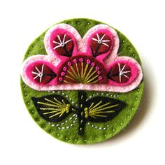 make up a pin on felt flower using colors from the dress