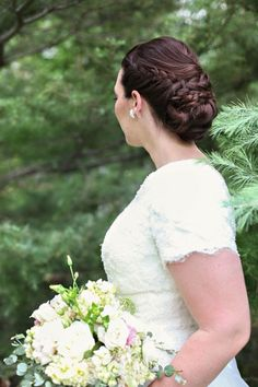 Braids This braided bun is a classic, stylish choice; plus, it helps summertime brides stay cool in sweltering temps.