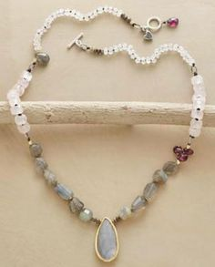 """Misty Necklace by Nicole Ardis Jewelry featured in Sundance Catalog. Item No. 64349 $138.00 Rainbow moonstone and rose quartz glow above garnet briolettes, pyrite, 14kt gold plated beads and iridescent labradorite, shimmering like water. Sterling toggle. Exclusive. 17""""L. http://www.sundancecatalog.com/product/64349.do #nicoleardis #jewelry #sundance #catalog #sundancecatalog #rustic #necklace #women #fashion #gold #shimmer #natural #beauty #unique #oneofakind #exclusive #moonstone #rose…"""