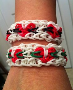 Kathy Nave. Rainbow Loom. Valentine's Day HEARTS bracelet. Find a tutorial here.  http://youtube/Hlk1kpQC4HY.