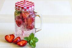 natural soda with strawberries in mason jar