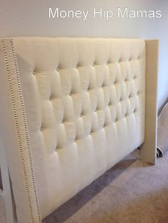 DIY Upholstered Headboard with Nailhead Detailed Arms | BlogHer - I love this. I might need to do something like this for the guest bedroom.
