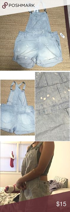 Striped Overalls Size too big on me, I tried my best to model😅.  Soft and light. 5 pockets with a zipper and button on the side. Adjustable straps. With white spotting. 100% cotton. (Last two pics not mine, I give the credit to orig. owner). You can wear it with a longer sleeve for the colder days. Old Navy Shorts Jean Shorts