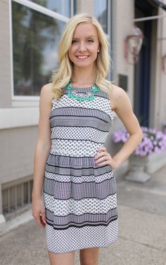 Lola Floral Stripe Dress at Dress and Dwell - Good things for you and your home. This adorable white and black striped floral dress is a great addition to any wardrobe