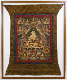 Lot 246: Framed Tibetan Thangka; Having painted Buddha images throughout the woven silk fabric, possibly featuring Mahayana