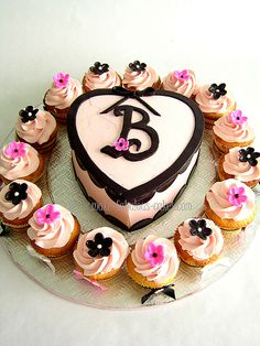 Bridal shower cupcakes with cake by fabcakelady, via Flickr
