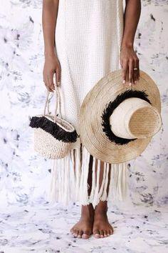 Handwoven wide brim hat with Frieda fringe. Handcrafted by artisans in Rwanda.