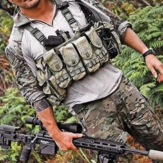 Military style camouflage (OCPs) and chest rig.