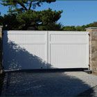 Cellular Vinyl Universal Board Gate - Privacy without fussiness is exhibited in this cellular vinyl board entrance gate with a subtle horizontal parallel touch three-quarters of the way up. Factory prepainted