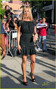 """Put a ring on it! Jennifer Aniston seen arriving at the """"Daily Show with Jon Stewart"""" in New York City with what looks like a ring on her en..."""