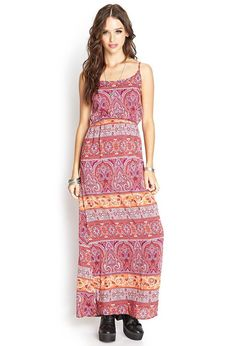 Style Deals - This soft woven maxi dress features a vibrant paisley print and adjustable shoulder...